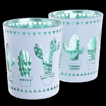 to telysholdere i hvitt og grønt metalisk preg med dekorative kaktuser